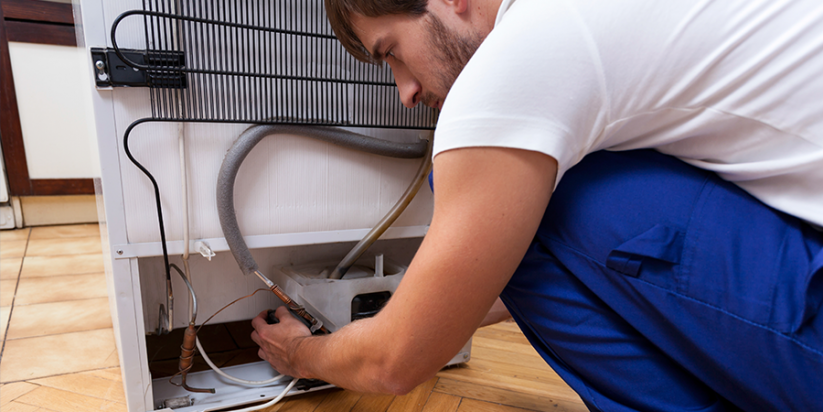 Appliance Allstars repairman fixes refrigerator, Refrigerator repair Hampton GA and all of South Atlanta
