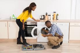 Appliance Repair technician repairng dryer